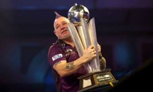 Peter Wright celebrates with the trophy.