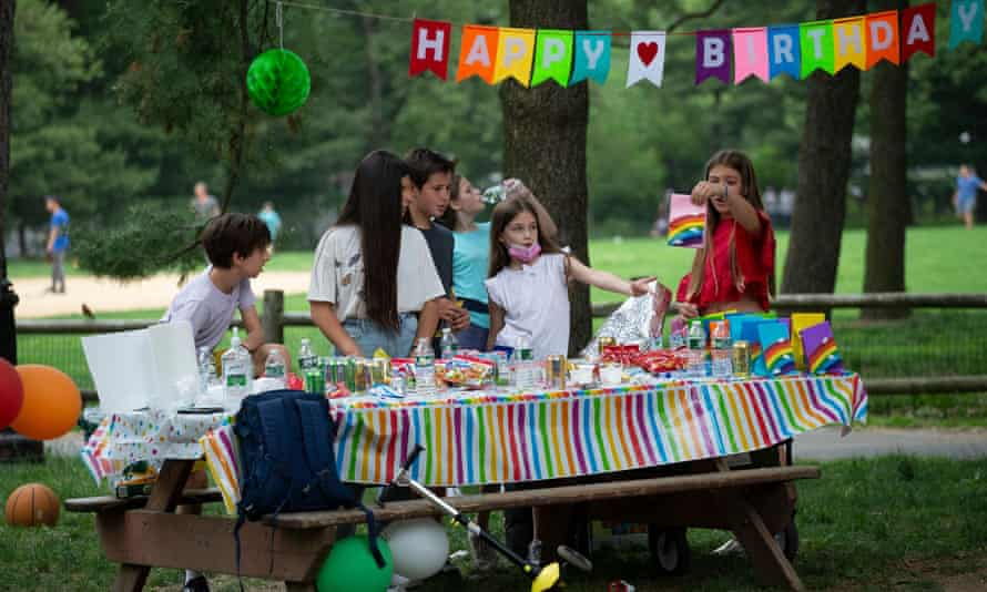 Children celebrate a birthday in Central Park, New York in May.