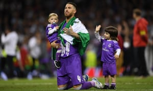 Sergio Ramo's children join him on the pitch to celebrate Real Madrid's victory.