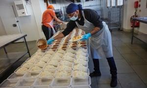 Kitchen staff portion out meals at the Guru Nanak Darbar gurdwara in Gravesend, Kent