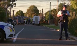 Police officers and vehicles seen behind a cordon in the Phillipstown area of Christchurch, New Zealand
