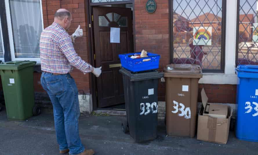 A volunteer delivering food boxes
