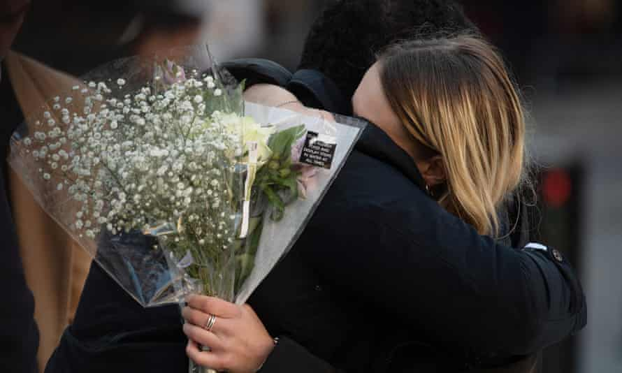 Mourners attend a vigil at Guildhall Yard in London