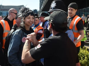 Saffiyah Khan, in a Specials T-shirt, staring down English Defence League protester Ian Crossland in Birmingham, April 2017.