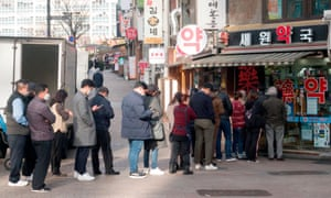 People wait to buy face masks in the South Korean capital, Seoul