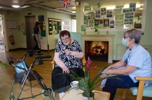 Carer Linda Mckean and resident Janet Kerr hear Janet's request (Faith by George Michael) being played on the radio.