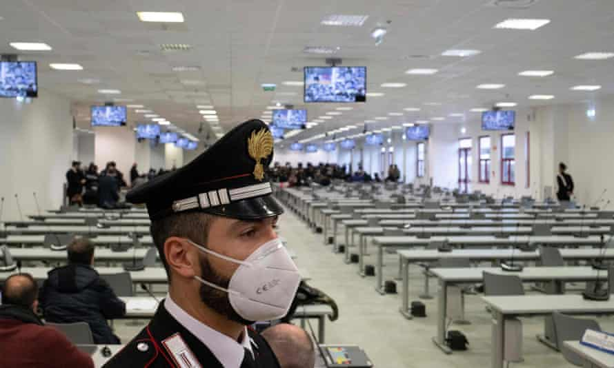 A Carabinieri police officer stands guard at the start of the trial of more than 350 alleged members of Calabria's 'Ndrangheta mafia group and associates