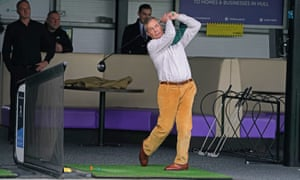 Nigel Farage playing golf on a range at One Stop Golf in Hull.
