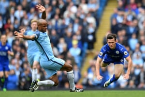 Manchester City's Vincent Kompany, left, checks Leicester City's English defender Ben Chilwell.