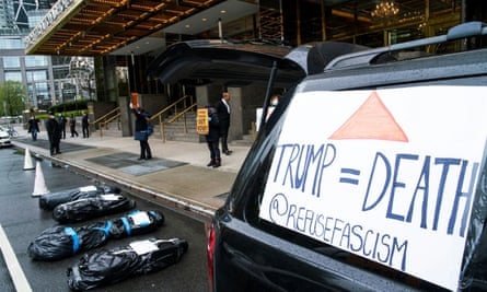 Fake body bags are seen during a protest against Donald Trump and his policies outside Trump International Hotel on 18 April.