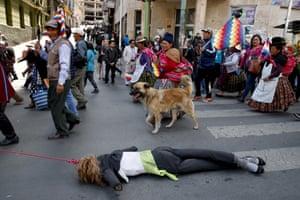 Demonstrators drag an effigy of Bolivia's interim President Jeanine Anez in La Paz.