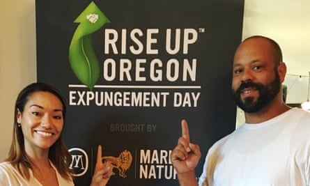 Minority Cannabis Business Association vice chair Jeannette Ward, left, with a man named Jacob, right, who got his record expunged of marijuana charges in August.
