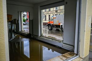 A fire truck is seen through the damaged windows of a building flooded by the Volme River in Dahl near Hagen, Germany