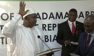 Adama Barrow is sworn in as president of the Gambia at the country's embassy in Dakar, Senegal.