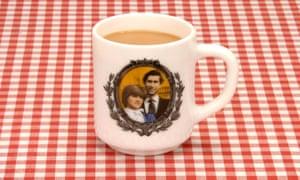 A Charles and Diana commemorative mug.