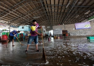 Workers disinfect the shrimp market in Samut Sakhon.