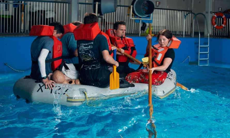 Rachel Hall with a group of journalists experiencing what it's like to try to cross the canal in a small dinghy at RNLI's Sea Survival Center in Poole,