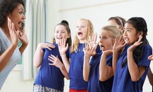 Children with teacher enjoying drama class.