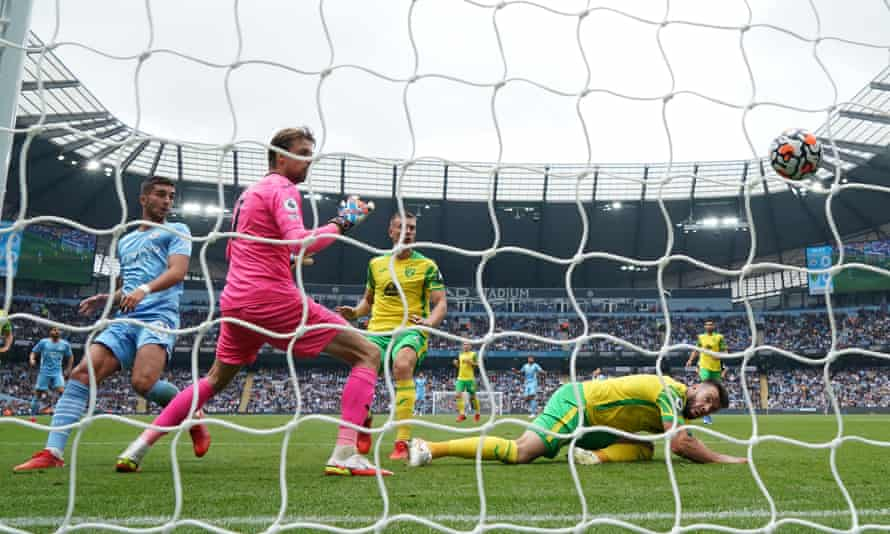 Tim Krul watches the ball cross the line.