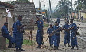 Police in Bujumbura hold a position during pre-election protests against President Pierre Nkurunziza