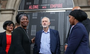 Jeremy Corbyn speaking to Asher Craig, deputy mayor of Bristol City Council (2nd left) during his visit to the Alone with Empire exhibition at City Hall in Bristol today.