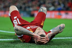 Alberto Moreno dejected after Liverpool loose 3-2 to West Bromwich Albion at Anfield.