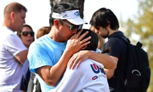 Students are reunited with their parents in Santa Clarita, California, after a shooting that killed two and wounded three.