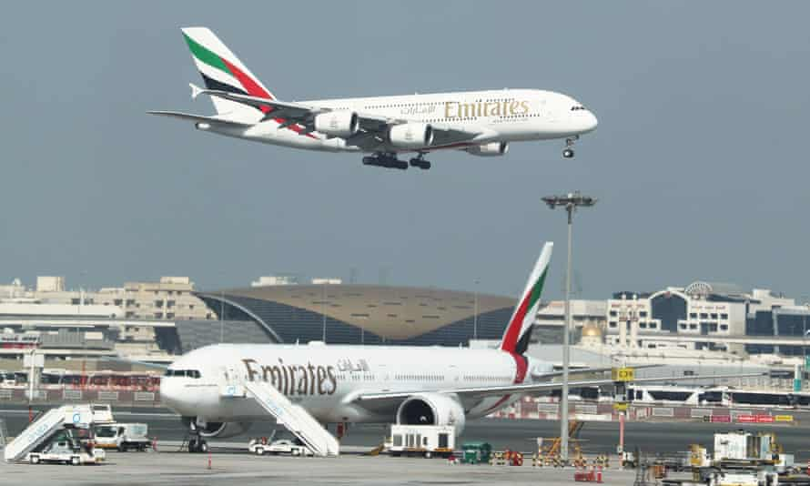 An Emirates flight approaches for landing at Dubai airport