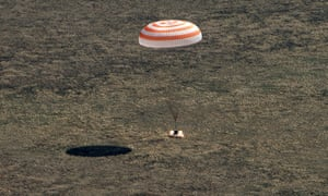 The capsule Soyuz MS-15 carrying the crew lands in Kazakhstan.