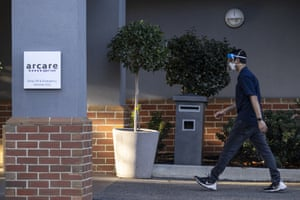 A staff member is seen entering Arcare Aged Care facility in Maidstone, Melbourne.