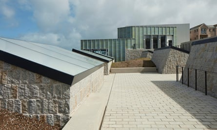 Six four-metre-deep light-wells are topped with honeycomb-filled glass at the new Tate St Ives extension.