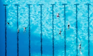 Aerial view taken from an ultralight aircraft on July 24, 2018 shows bathers in the Ricklinger Bad public swimming pool in Hanover, Germany.