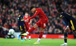 Alex Oxlade-Chamberlain of Liverpool marks the third goal of his game.