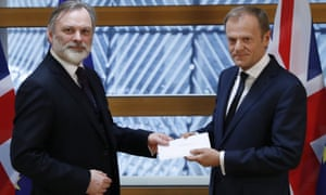 Britain's ambassador to the EU , Tim Barrow, delivers Theresa May's formal notice of the UK's intention to leave the bloc under article 50 of the Lisbon treaty to European council President Donald Tusk.