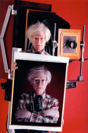 Andy Warhol with a polaroid camera, New York, 1980