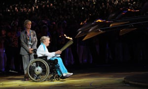 Margaret Maughan lights the cauldron bearing the Paralympic flame at the 2012 London Paralympic Games.