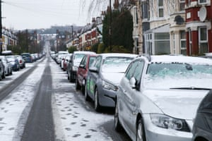 Streets and cars covered in snow