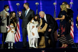 Biden and Harris gather with their family members after addressing the nation from the Chase Center.