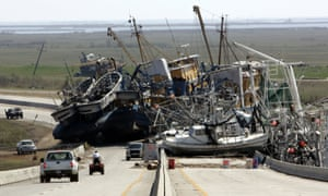A tangle of fishing boats block a highway in Empire, Louisiana, after Hurricane Katrina struck.