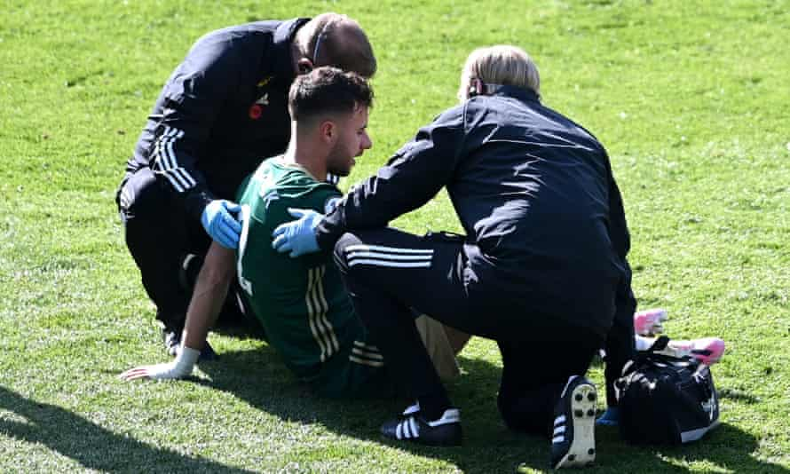 George Baldock receives medical treatment before eventually being substituted during Sheffield United's defeat at Leeds.