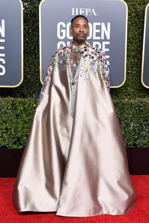 Billy Porter in a Randi Rahm custom couture taupe silk cape complete with hot pink lining.