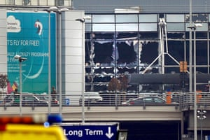 Broken windows seen at the scene of explosions at Zaventem airport
