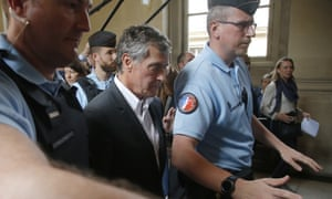 Jérôme Cahuzac, escorted by police officers,