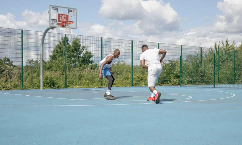Basketball players on the court at Finsbury Park, north London