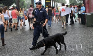 Police drug detection dogs encourage festivalgoers to