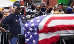 An Alabama state trooper salutes the casket.