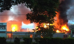 Fire engulfs a building in Port Moresby after riots broke out in the capital city of Papua New Guinea.