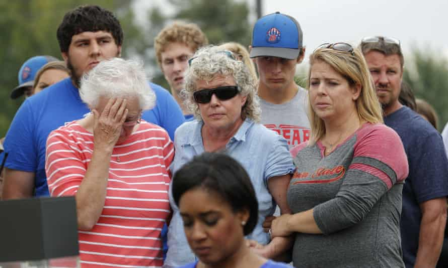 Friends and family of Mollie Tibbetts react during a news conference on Tuesday.