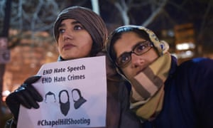 Women take part in a vigil for three young Muslims killed in Chapel Hill, North Carolina, this week.