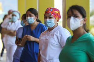 Health workers queue at the Hospital Maria to receive a dose of the Moderna coronavirus vaccine, in Tegucigalpa, Honduras on 25 February, 2021.